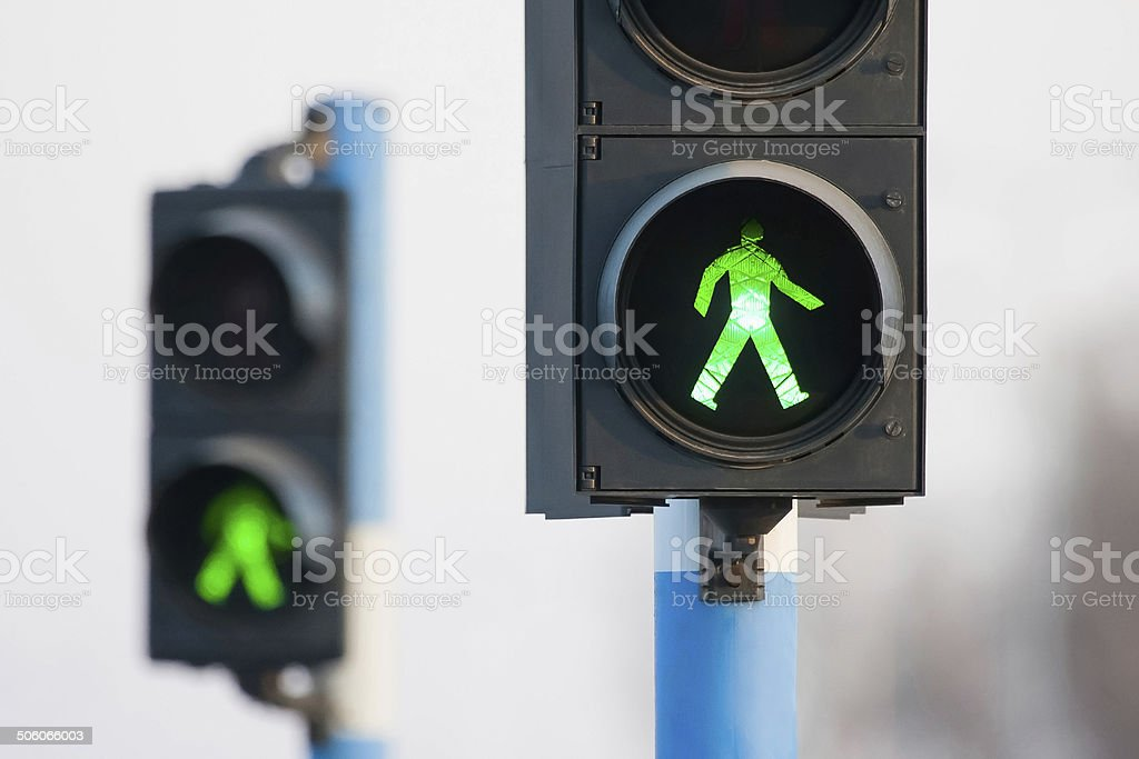 Two green lights for pedestrians stock photo