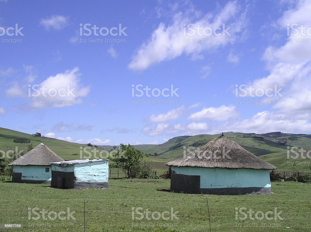 Two green native huts in South Africa royalty-free stock photo