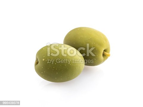 Two green olives isolated on white background, close up.