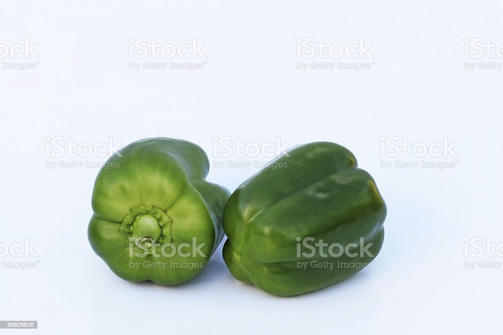 Two green peppers - white background royalty-free stock photo