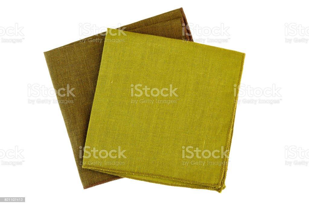 Two green textile napkins on white stock photo
