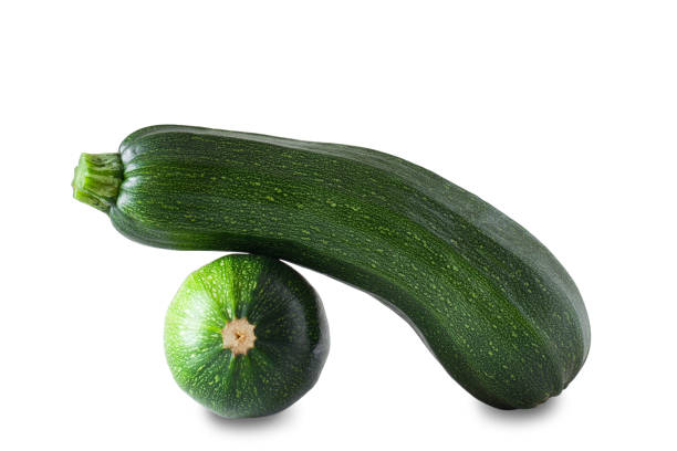 Two green zucchini isolated on white background. Clipping path. stock photo