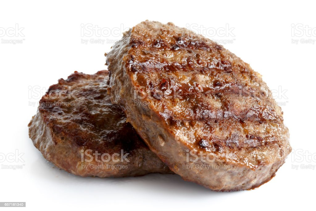 Two grilled hamburger patties isolated on white. stock photo