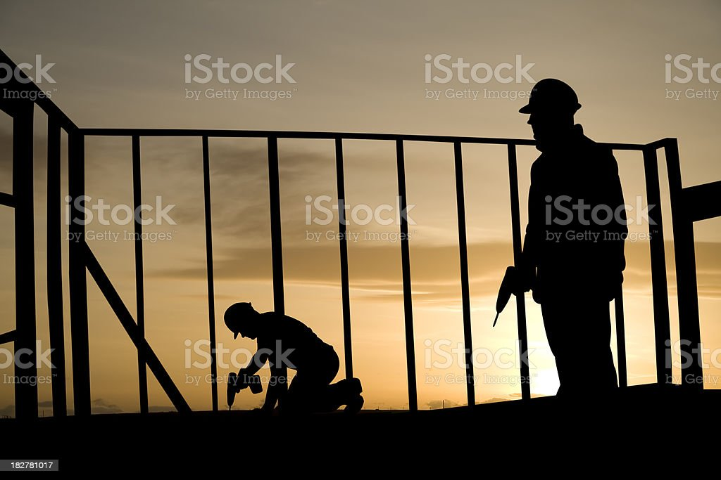 Two Guys Drilling royalty-free stock photo