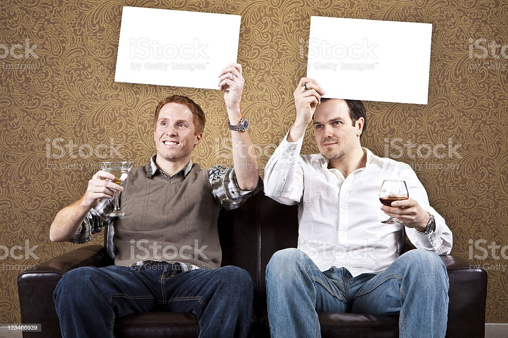 Two guys in a bar with blank signs stock photo