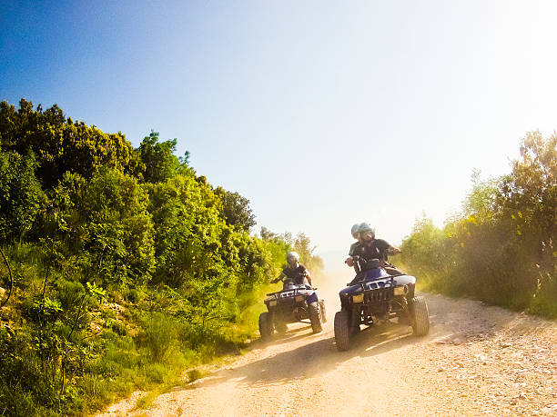 two guys on quad bikes in mountain trail two guys on quad bikes on mountain trail quadbike stock pictures, royalty-free photos & images