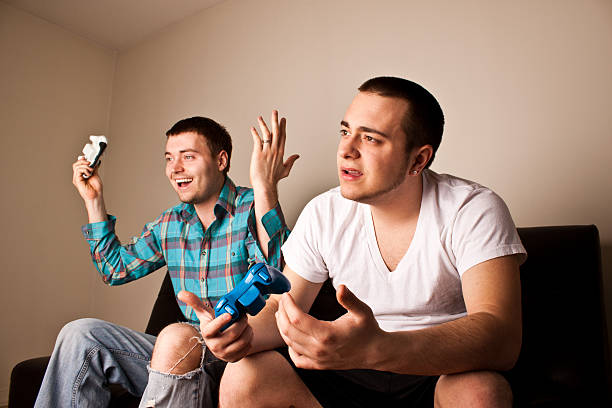 Two Guys Playing VG One Wins stock photo