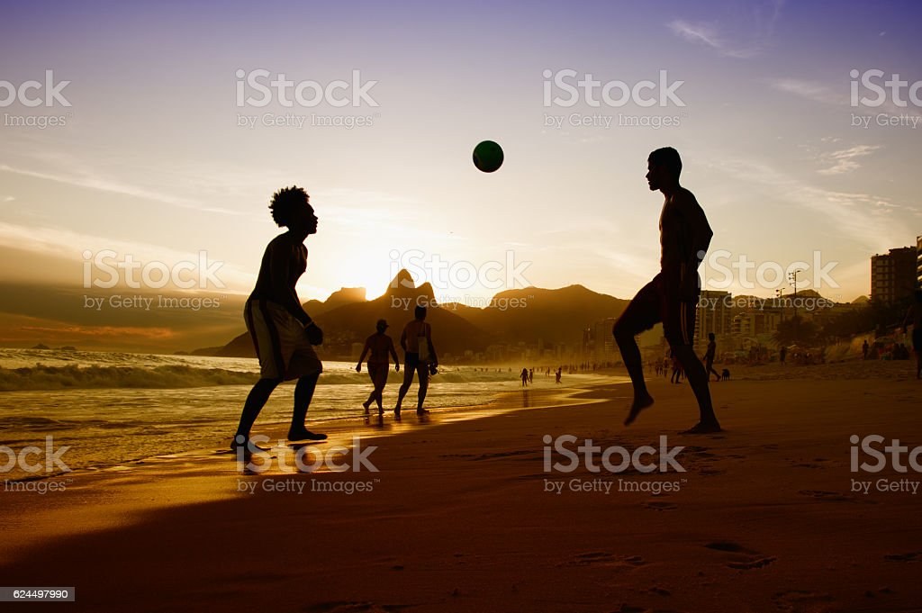 Two guys with ball at beach at Rio de Janeiro stock photo