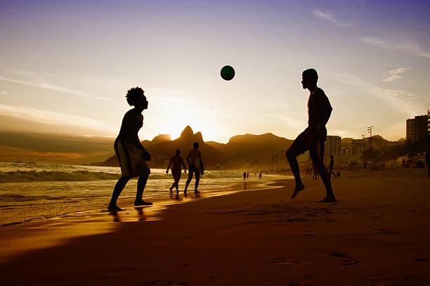 two guys with ball at beach at rio de janeiro - futebol de areia - fotografias e filmes do acervo