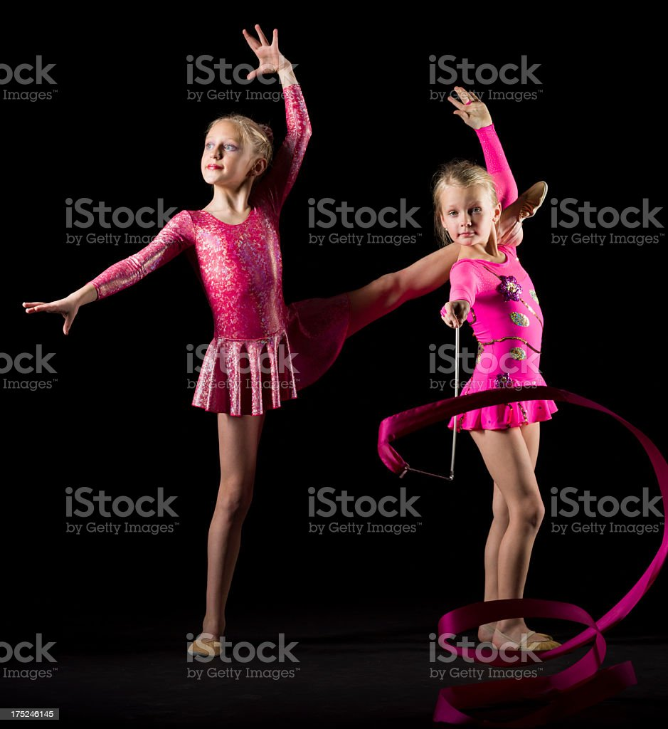Two Gymnast girls on black background royalty-free stock photo