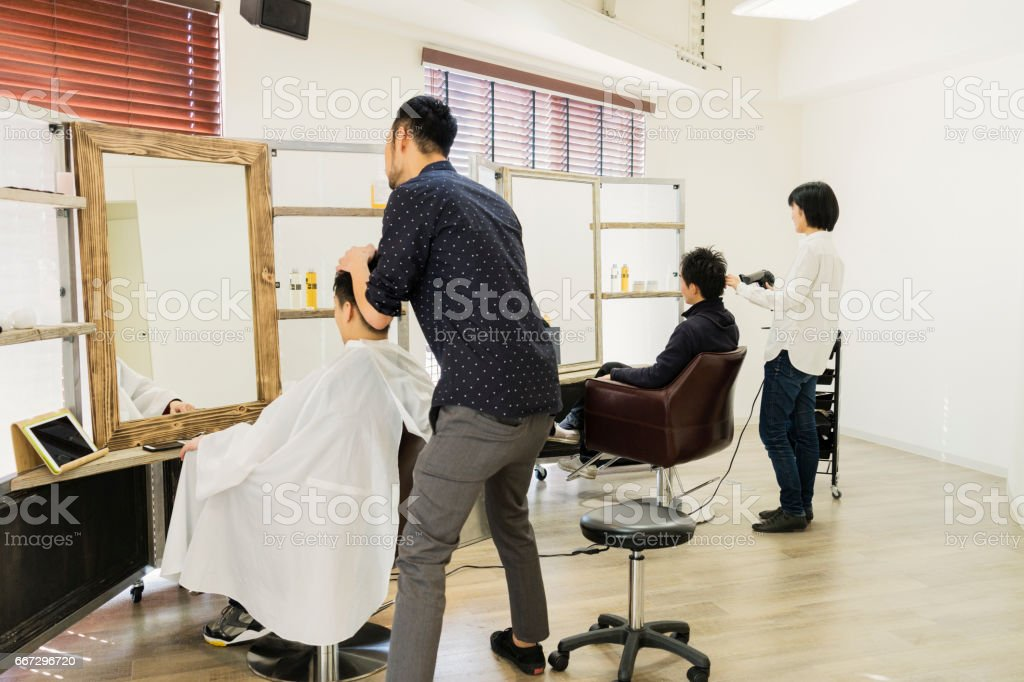 Two hair stylist owner working in own hair salon stock photo