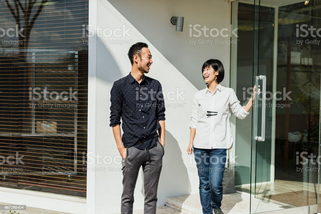 Two Hair Stylists Standing Outside Hair Salon Shop Stock Photo Istock