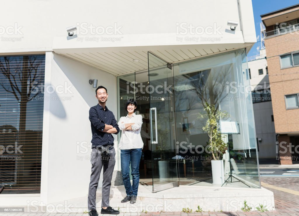 Two Hair Stylists Standing Outside Hair Salon Shop Stock Photo