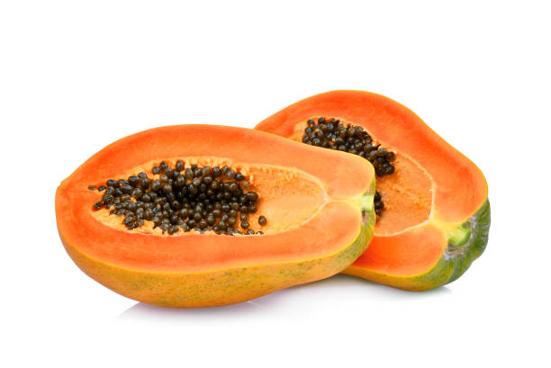 two half cut of ripe papaya with seeds isolated on white background – zdjęcie