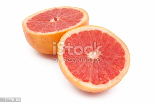 Two half-cut grapefruits. Isolated on white