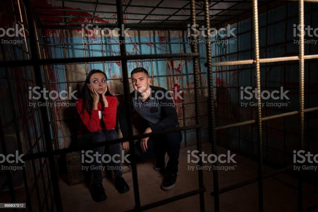 Two Halloween victims in a cage stock photo