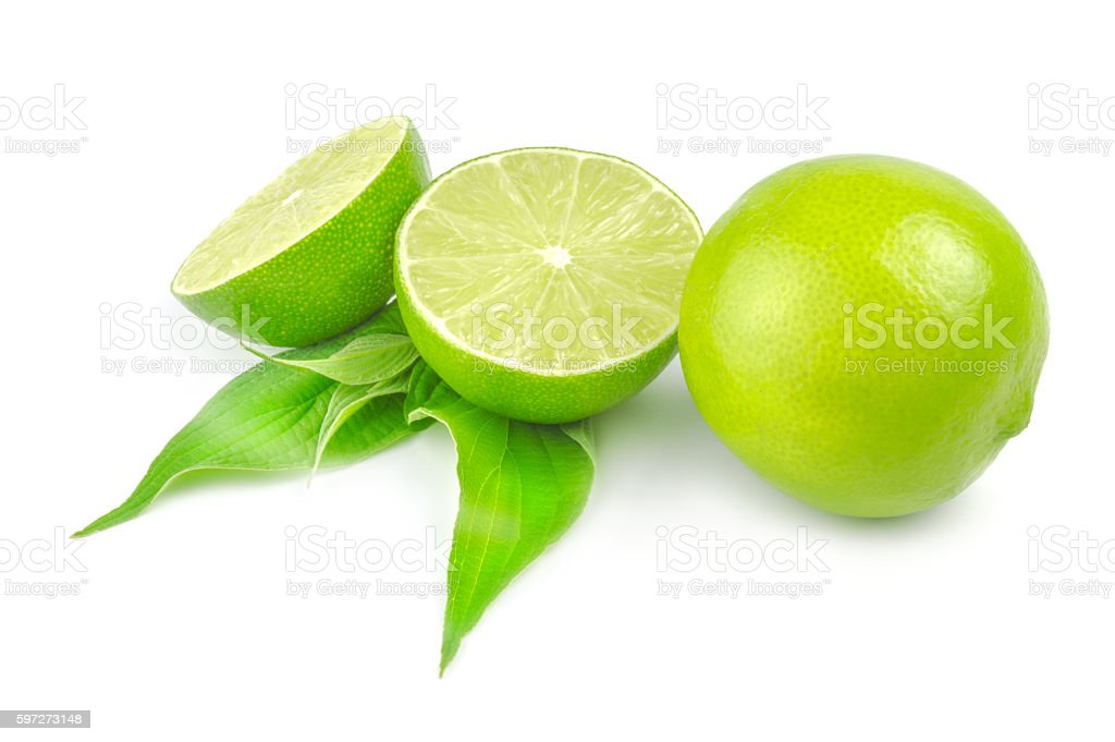 Two halves and whole lime with leaf royalty-free stock photo