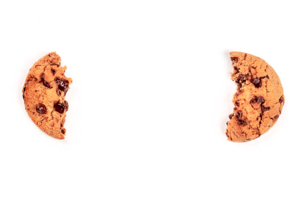 Two halves of a chocolate chip cookie, shot from above on a white background, like brackets, forming a frame for copy space Two halves of a chocolate chip cookie, shot from above on a white background, like brackets, forming a frame for copy space chocolate chip cookie stock pictures, royalty-free photos & images