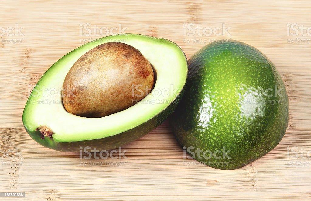 Two halves of avocado royalty-free stock photo