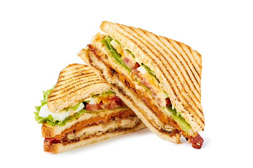 Two halves of club sandwich isolated on white background. Clipping path included