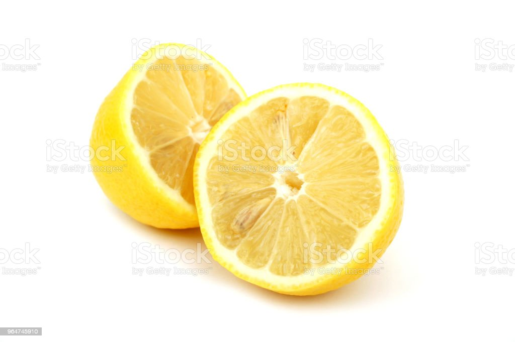 Two halves of lemon on white background royalty-free stock photo
