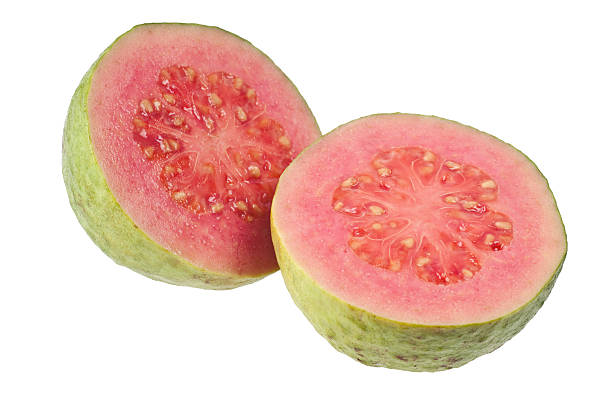 Two halves pink guava Halves pink guava isolated on white background guava stock pictures, royalty-free photos & images