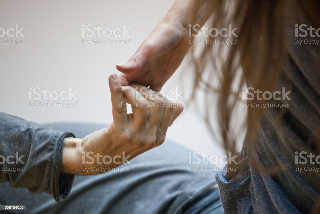 two hand dance.The hands of the dancers are drawn to each other.dancers' hands support each other stock photo