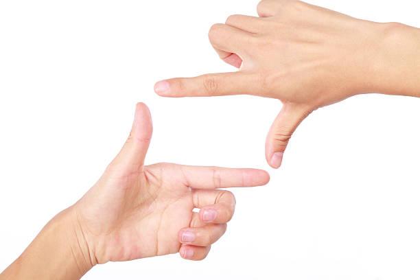 Zwei hand finger frame auf weißem Hintergrund – Foto