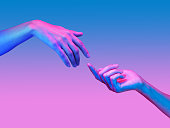 istock Two hand in a pop art collage style in neon bold colors. Modern psychedelic creative element with human palm for posters, banners, wallpaper. Copy space for text. Magazine style. Zine culture. 1225203324