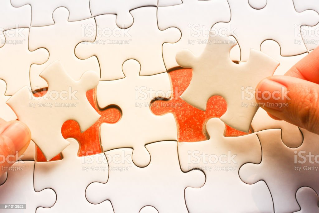 two Hand put the last piece of jigsaw puzzle to complete the mission.,Business strategy concept. stock photo