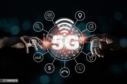 1152653473 istock photo Two Hand touching to 5G wireless network telecommunication and mobile internet signal. Internet of thing IOT high speed and change the world. Technology business concept. 1213865629