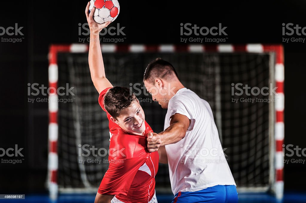 Two handball players in action. stock photo