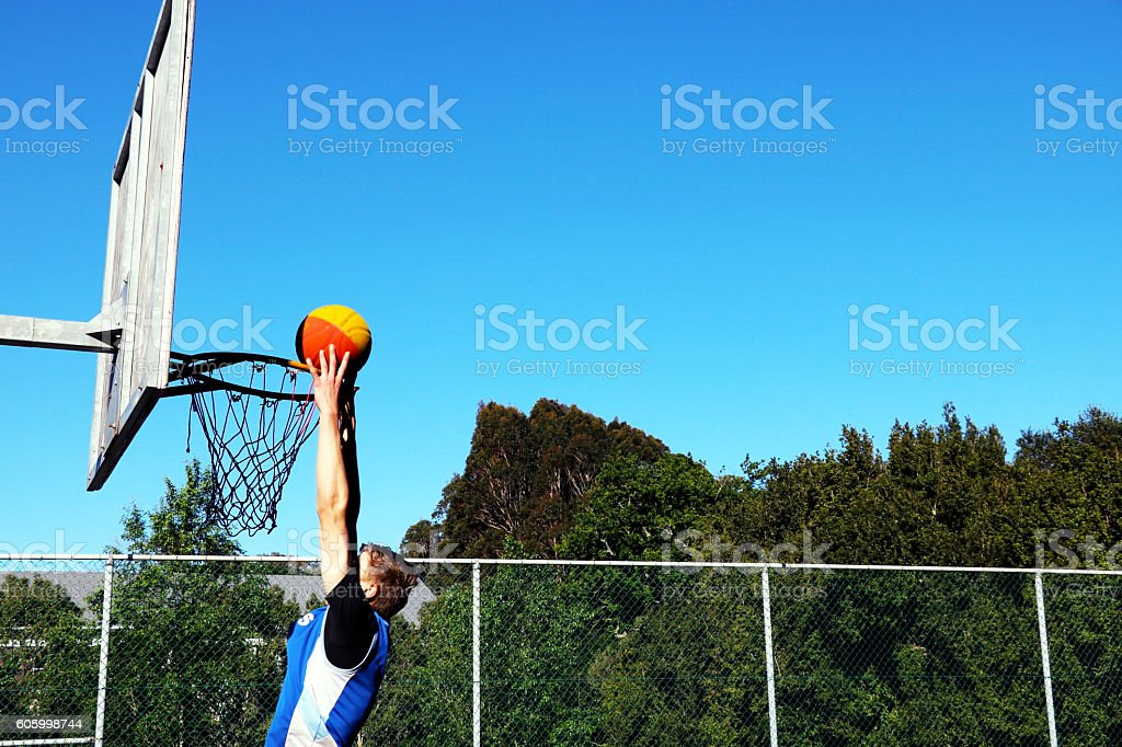 Two handed basketball dunk stock photo