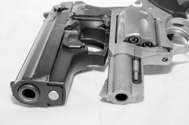 Two handguns, a 40 caliber pistol and a 357 magnum revolver stock photo