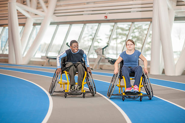 two handicapped friends at the gym - wheelchair sports stock photos and pictures