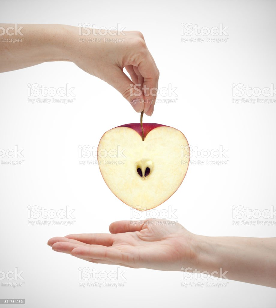 two hands and an apple stock photo