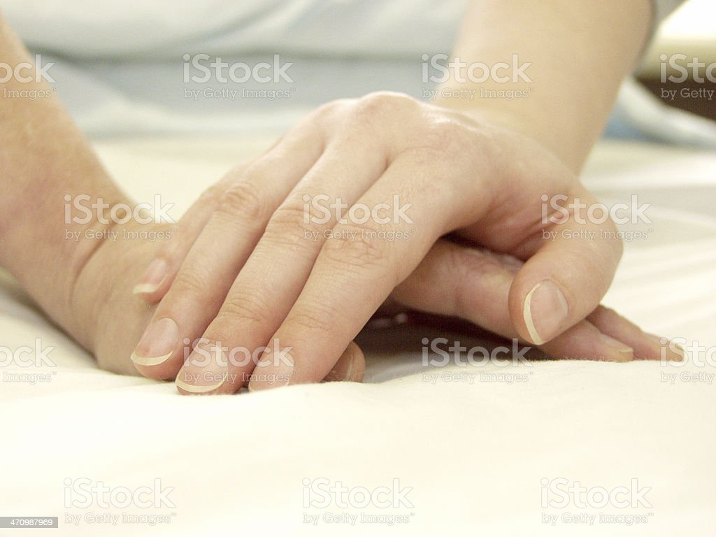 Two hands clasp in hospital royalty-free stock photo