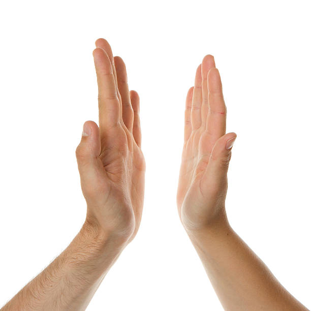 Two hands coming together in a high five on white background stok fotoğrafı