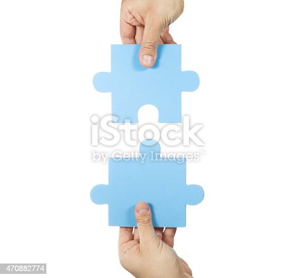 173706624istockphoto Two hands connecting puzzle pieces 470882774