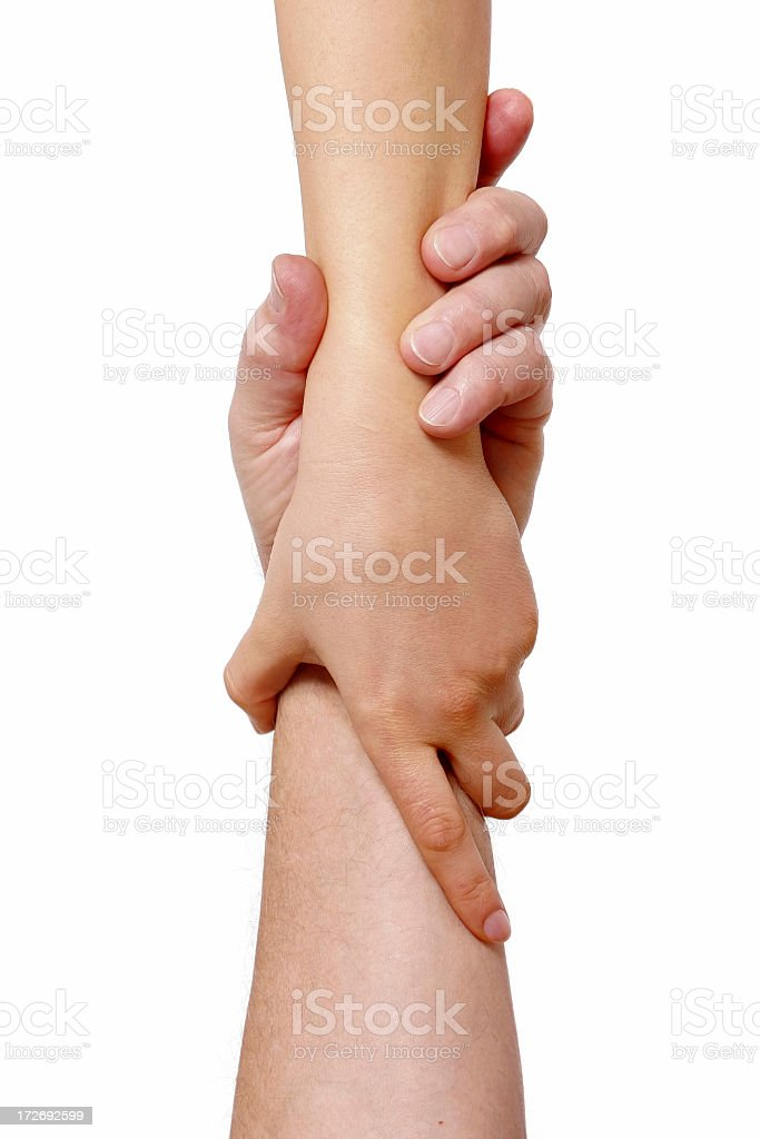 Two hands, each clasping the other forearm in a grasp royalty-free stock photo