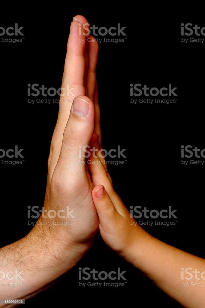 Two hands: father and daughter royalty-free stock photo