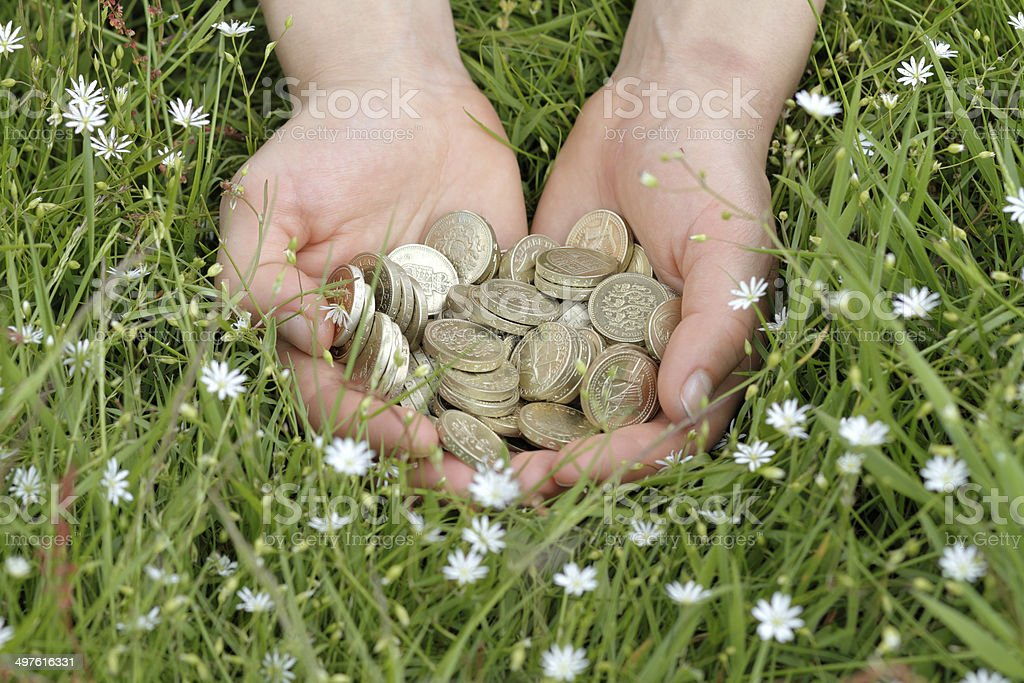 Money in the countryside pounds by the handful stock photo