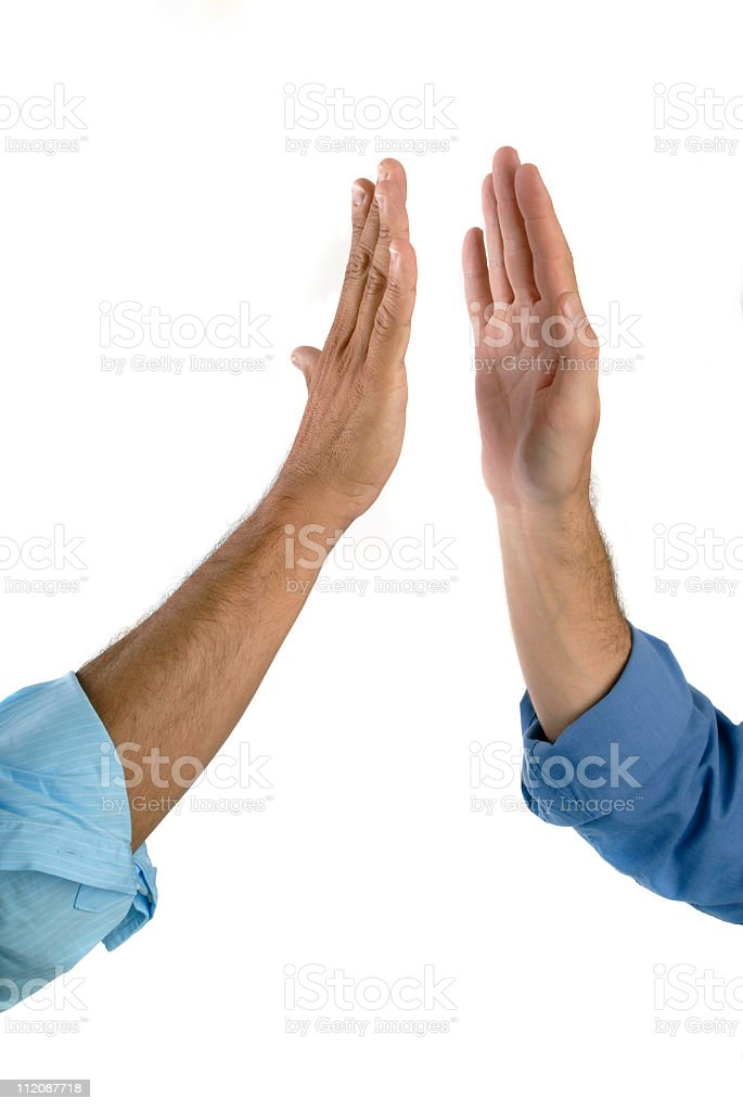 Two hands getting ready to give a high five royalty-free stock photo