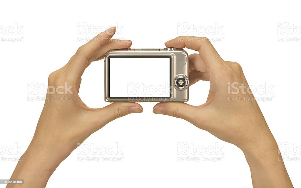 Two hands hold a digital camera with a blank screen royalty-free stock photo