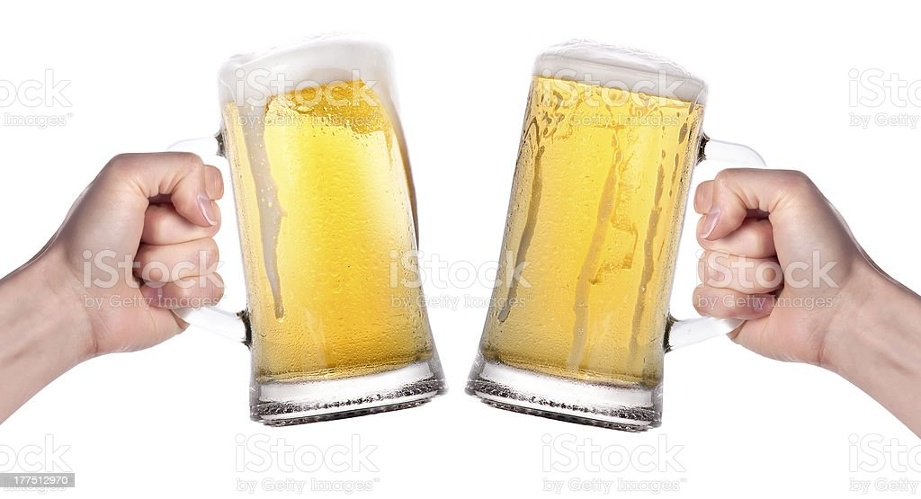two hands holding beers making a toast stock photo