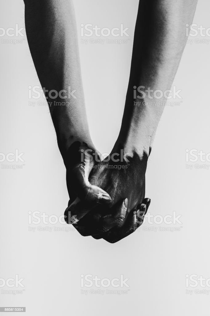 Two hands holding each other stock photo