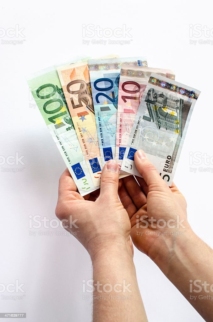Two hands holding Euro banknotes royalty-free stock photo