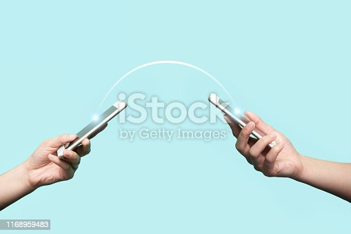 Two hands holding mobile phones