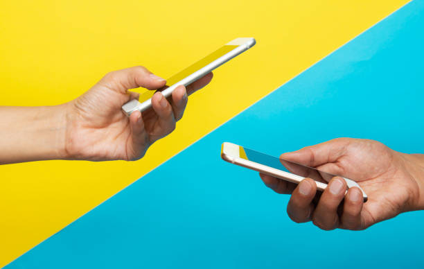 Two Hands Holding Mobile Phones stock photo