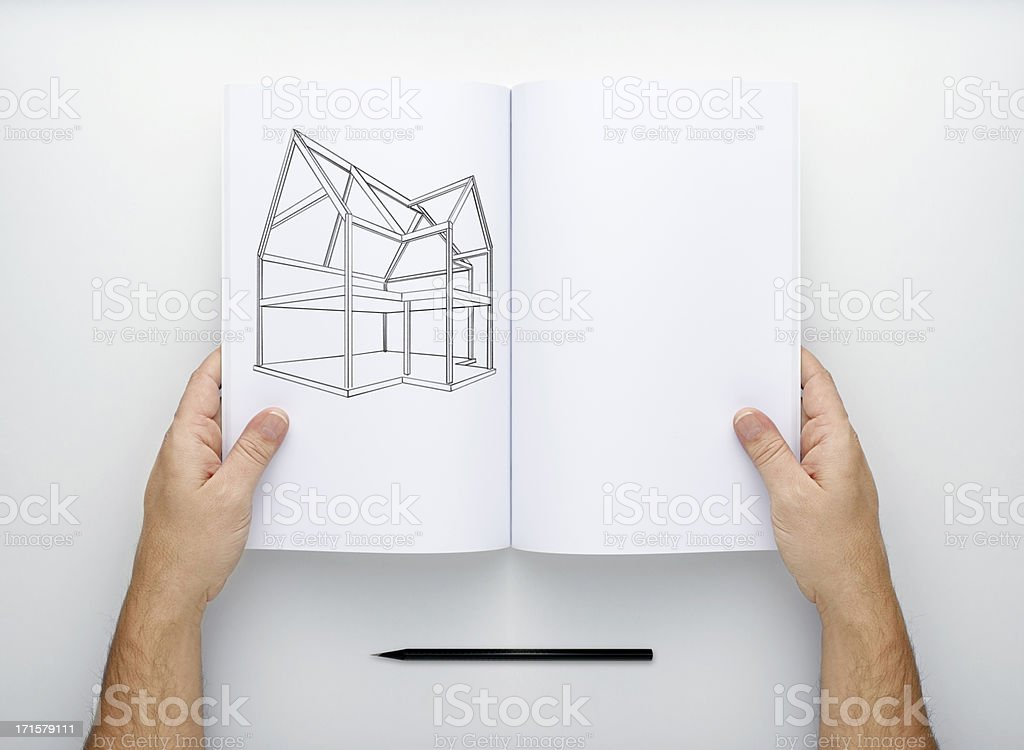 Two Hands Holding Open A Blank Magazine stock photo